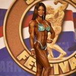 Candice Lewis takes Ms. Figure International.jpg