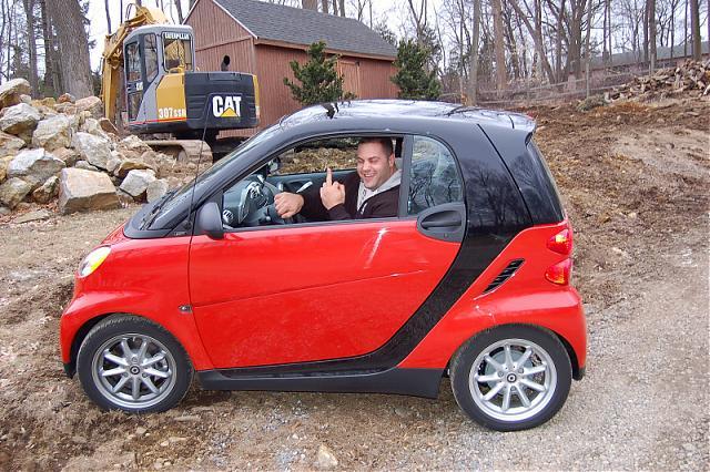 Evan Centopani wearing a car