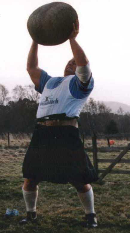 Laine Snook -deadlifting two Millennium Dumbbells